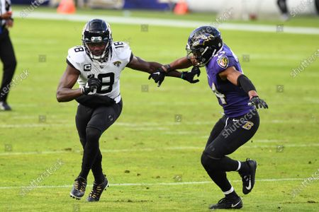 Jacksonville Jaguars wide receiver Chris Conley (18) in action against Baltimore Ravens cornerback Marlon Humphrey (44) during the second half of an NFL football game, in Baltimore