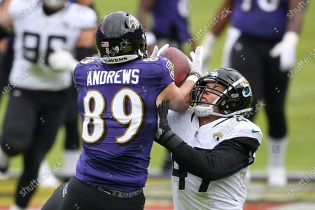 Baltimore Ravens tight end Mark Andrews (89) makes a catch against Jacksonville Jaguars linebacker Joe Schobert (47) during the first half of an NFL football game, in Baltimore