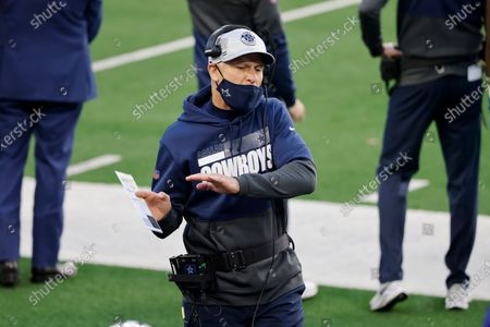 Dallas Cowboys defensive coordinator Mike Nolan talks to players on the sideline during the first half of an NFL football game against the San Francisco 49ers in Arlington, Texas