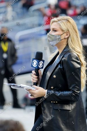 Stock Photo of Sideline reporter Melanie Collins works reports during an NFL football game in Arlington, Texas