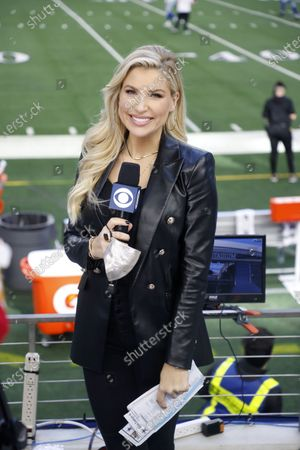 Sideline reporter Melanie Collins works during an NFL football game in Arlington, Texas
