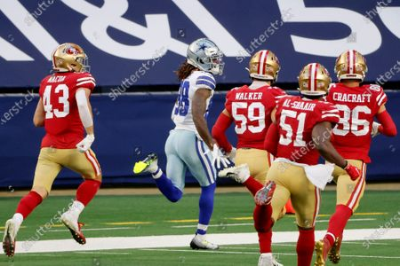 Dallas Cowboys wide receiver CeeDee Lamb (88) sprints to the end zone returning an onside kick for a touchdown as San Francisco 49ers Kai Nacua (43), Joe Walker (59), Azeez Al-Shaair (51) and River Cracraft (86) give pursuit in the second half of an NFL football game in Arlington, Texas