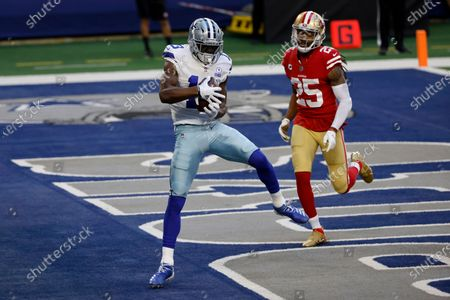 Dallas Cowboys wide receiver Michael Gallup (13) catches a touchdown pass in front of San Francisco 49ers cornerback Richard Sherman (25) in the first half of an NFL football game in Arlington, Texas