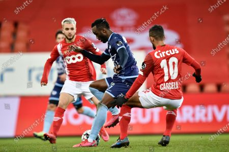 Mouscron's Fabrice Olinga and Standard's Mehdi Carcela fight for the ball during a soccer match between Standard de Liege and RE Mouscron, Sunday 20 December 2020 in Liege, on the seventeenth day of the 'Jupiler Pro League' first division of the Belgian championship.