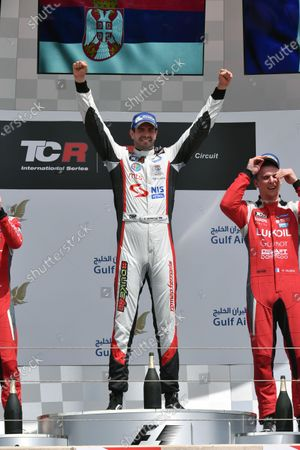 (L to R): Second placed James Nash (GBR) Lukoil Craft-Bamboo Racing SEAT Leon TCR, race winner Dusan Borkovic (MAL) and thrid placed Hugo Valente (FRA) Lukoil Craft-Bamboo Racing SEAT Leon TCR celebrate on the podium at TCR International Series, Race Two, Bahrain International Circuit, Sakhir, Bahrain, 16 April 2017.