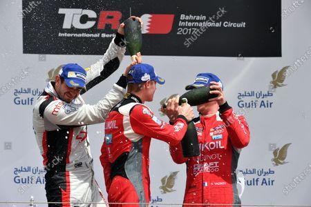 James Nash (GBR) Lukoil Craft-Bamboo Racing SEAT Leon TCR, Dusan Borkovic (MAL) and Hugo Valente (FRA) Lukoil Craft-Bamboo Racing SEAT Leon TCR celebrate on the podium at TCR International Series, Race Two, Bahrain International Circuit, Sakhir, Bahrain, 16 April 2017.