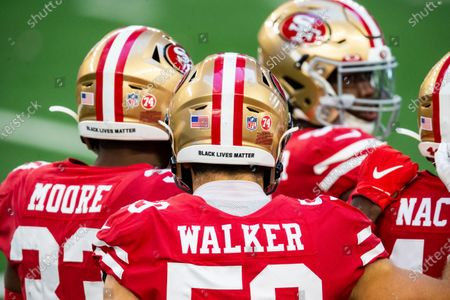 San Francisco 49ers linebacker Joe Walker (59) wears a Black Lives Matter sticker on his helmet to bring attention to social justice issues during an NFL football game against the Dallas Cowboys, in Arlington, Texas. Dallas won 41-33