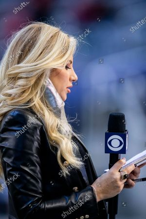 Stock Picture of Sideline reporter Melanie Collins reports before an NFL football game between the San Francisco 49ers and Dallas Cowboys, in Arlington, Texas. Dallas won 41-33