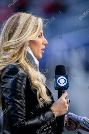 Sideline reporter Melanie Collins reports before an NFL football game between the San Francisco 49ers and Dallas Cowboys, in Arlington, Texas. Dallas won 41-33