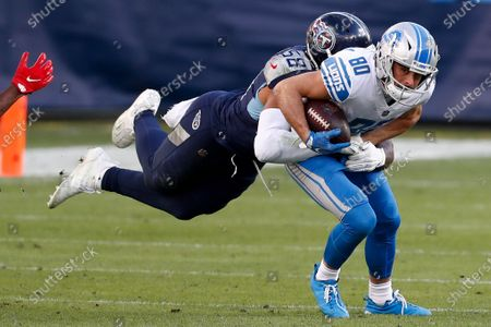 Detroit Lions wide receiver Danny Amendola is tackled by Tennessee Titans outside linebacker Harold Landry during the second half of an NFL football game, in Nashville, N.C