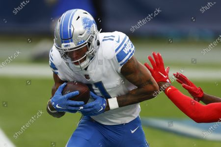 Detroit Lions wide receiver Marvin Jones scores against the Tennessee Titans during the first half of an NFL football game, in Nashville, N.C