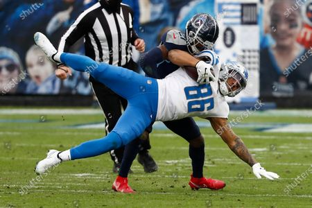 Detroit Lions tight end Hunter Bryant (86) is tackled by Tennessee Titans cornerback Malcolm Butler during the first half of an NFL football game, in Nashville, N.C