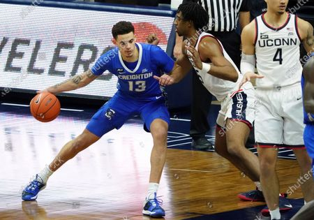 Creighton forward Christian Bishop (13) moves the ball against Connecticut forward Isaiah Whaley (5) in the second half of an NCAA college basketball game in Storrs, Conn