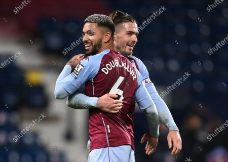 Douglas Luiz (L) and Jack Grealish (R) of Aston Villa celebrate their victory after the English Premier League soccer match between West Bromwich Albion and Aston Villa in West Bromwich, Britain, 20 December 2020.