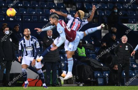 Manager Sam Allardyce (C-L) of West Bromwich and assistant Sammy Lee (R) react during the English Premier League soccer match between West Bromwich Albion and Aston Villa in West Bromwich, Britain, 20 December 2020.