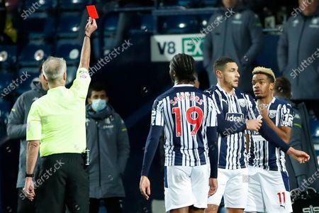 Referee Martin Atkinson shows a red card to West Bromwich Albion's Jake Livermore, second from right, during the English Premier League soccer match between West Bromwich Albion and Aston Villa at the Hawthorns, West Bromwich, England
