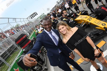 Stock Image of Genie Bouchard (CDN) Tennis Player and Bismack Biyombo, Basket Ball Player on the grid at Formula One World Championship, Rd7, Canadian Grand Prix, Race, Montreal, Canada, Sunday 11 June 2017.
