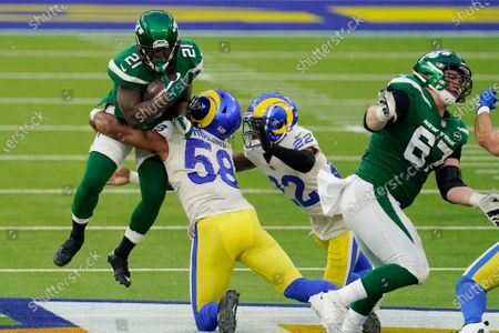 New York Jets running back Frank Gore (21) is tackled by Los Angeles Rams linebacker Justin Hollins (58) during the second half of an NFL football game, in Inglewood, Calif
