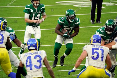 New York Jets running back Frank Gore carries against the Los Angeles Rams during the second half of an NFL football game, in Inglewood, Calif