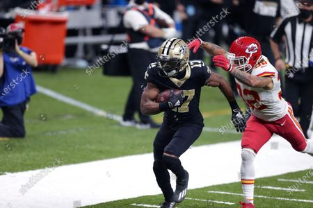 New Orleans Saints wide receiver Emmanuel Sanders (17) carries against Kansas City Chiefs strong safety Tyrann Mathieu (32) on a long pass reception in the first half of an NFL football game in New Orleans