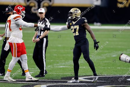Kansas City Chiefs defensive end Alex Okafor (57) and New Orleans Saints strong safety Malcolm Jenkins (27) before an NFL football game, in New Orleans