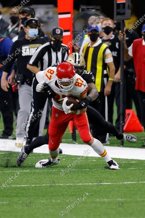 Kansas City Chiefs tight end Travis Kelce (87) is tackled boy New Orleans Saints strong safety Malcolm Jenkins (27) during an NFL football game, in New Orleans