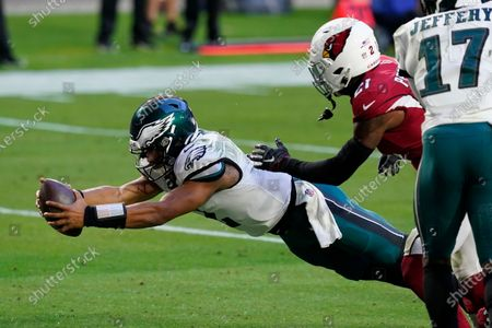 Philadelphia Eagles quarterback Jalen Hurts (2) dives in for a touchdown as Arizona Cardinals cornerback Patrick Peterson (21) defends during the second half of an NFL football game, in Glendale, Ariz