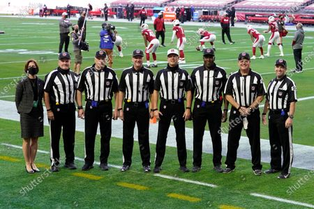 From right; field judge Aaron Santi, head linesman Jerry Bergman, umpire Ruben Fowler, referee Craig Wrolstad, line judge David Oliver, back judge Keith Ferguson, side judge Jeff Lamberth and replay official Terri Valenti prior to an NFL football game between the Arizona Cardinals and the Philadelphia Eagles, in Glendale, Ariz