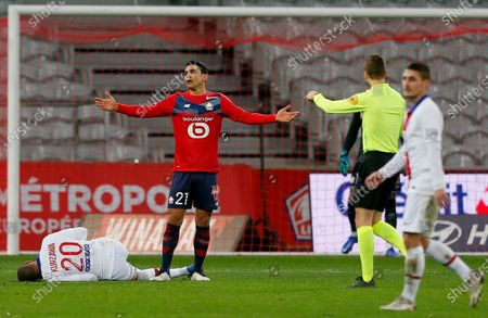 Stock Picture of Lille's Benjamin Andre reacts after a foul on PSG's Layvin Kurzawa during the French League One soccer match between Lille and Paris Saint-Germain at the Stade Pierre Mauroy stadium in Villeneuve d'Ascq, northern France