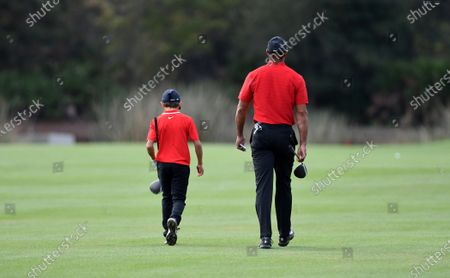 Stock Picture of Tiger Woods and his son Charlie walk the fairway on the second hole during the final round
