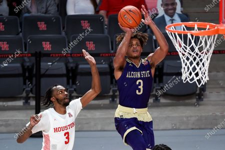 Alcorn State guard David Pierce, right, shoots as Houston guard DeJon Jarreau defends during the second half of an NCAA college basketball game, in Houston