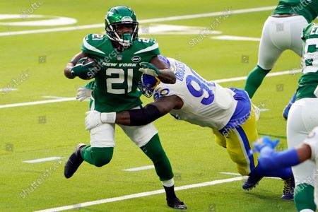 New York Jets running back Frank Gore (21) is tackled by Los Angeles Rams defensive end Michael Brockers (90) during the first half of an NFL football game, in Inglewood, Calif