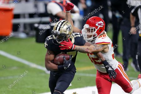 Kansas City Chiefs strong safety Tyrann Mathieu (32) tackles New Orleans Saints wide receiver Emmanuel Sanders (17) on a 51-yard pass play in the first half of an NFL football game in New Orleans