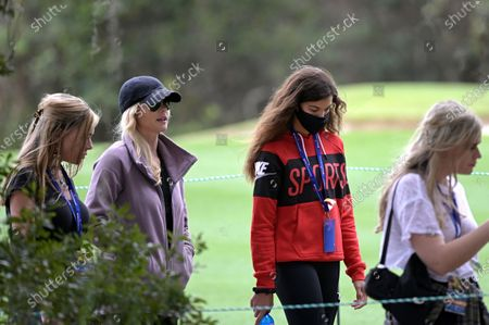 Elin Nordegren, second from left, and Sam Alexis Woods, second from right, follow Tiger Woods and Charlie Woods to the 11th hole during the final round of the PNC Championship golf tournament, in Orlando, Fla