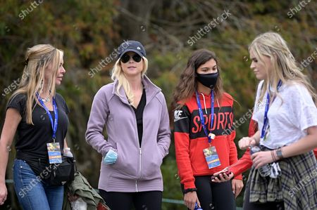 Elin Nordegren, second from left, and Sam Alexis Woods, second from right, follow Tiger Woods and Charlie Woods on the 11th hole during the final round of the PNC Championship golf tournament, in Orlando, Fla
