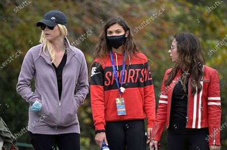 Elin Nordegren, left, Sam Alexis Woods, center, and Erica Herman follow Tiger Woods and Charlie Woods on the 11th hole during the final round of the PNC Championship golf tournament, in Orlando, Fla