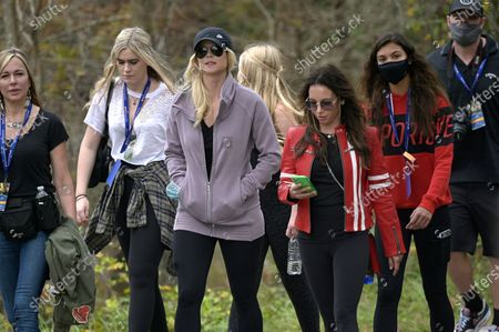 Elin Nordegren, third from left, Sam Alexis Woods, second from right, and Erica Herman, third from right, follow Tiger Woods and Charlie Woods on the 12th hole during the final round of the PNC Championship golf tournament, in Orlando, Fla