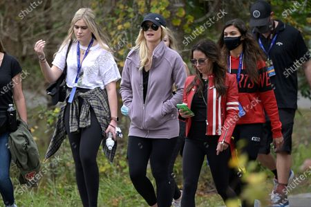 Elin Nordegren, second from left, Sam Alexis Woods, second from right, and Erica Herman, third from right, follow Tiger Woods and Charlie Woods on the 12th hole during the final round of the PNC Championship golf tournament, in Orlando, Fla