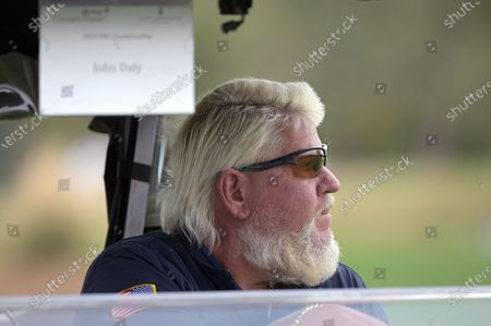 John Daly drives a cart to the 18th green during the final round of the PNC Championship golf tournament, in Orlando, Fla