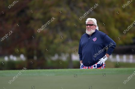 John Daly waits to hit from a bunker at the 18th green during the final round of the PNC Championship golf tournament, in Orlando, Fla