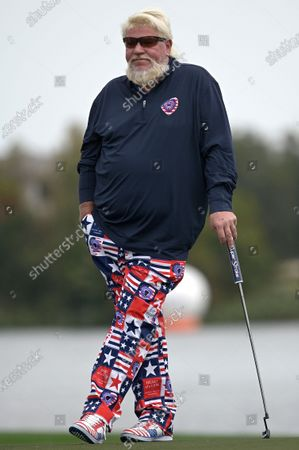 John Daly waits to putt on the 18th green during the final round of the PNC Championship golf tournament, in Orlando, Fla