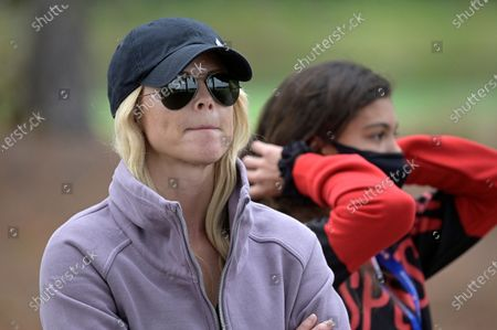 Elin Nordegren, left, and Sam Alexis Woods watch Tiger Woods and Charlie Woods on the 18th hole during the final round of the PNC Championship golf tournament, in Orlando, Fla