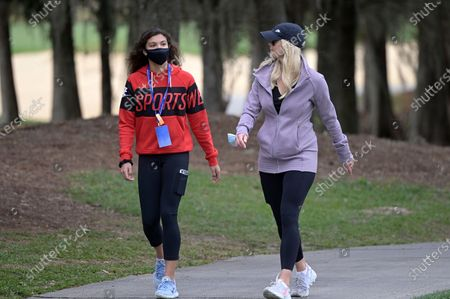 Elin Nordegren, right, and Sam Alexis Woods follow Tiger Woods and Charlie Woods on the 18th hole during the final round of the PNC Championship golf tournament, in Orlando, Fla