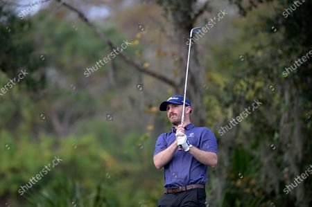 Eric Calcavecchia, son of golfer Mark Calcavecchia, watches his tee shot on the fourth hole during the final round of the PNC Championship golf tournament, in Orlando, Fla