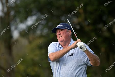 Mark Calcavecchia watches his tee shot on the fourth hole during the final round of the PNC Championship golf tournament, in Orlando, Fla