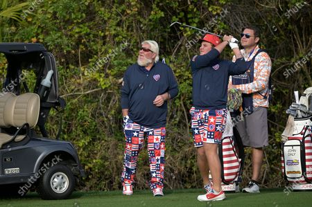 John Daly, left, watches as his son Little John Daly hits from the first fairway during the final round of the PNC Championship golf tournament, in Orlando, Fla