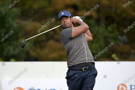 Qass Singh, son of golfer Vijay Singh, tees off on the first hole during the final round of the PNC Championship golf tournament, in Orlando, Fla