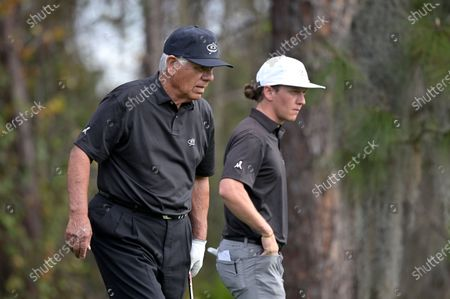 Lee Trevino, left, and his son Daniel Trevino survey the third green before attempting a putt during the final round of the PNC Championship golf tournament, in Orlando, Fla