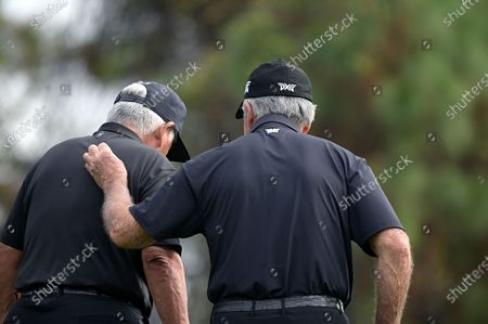 Gary Player, right, of South Africa, talks with Lee Trevino on the third green during the final round of the PNC Championship golf tournament, in Orlando, Fla