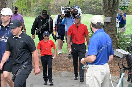Stock Photo of Tiger Woods and his son Charlie walk to the 11th tee during the final round of the PNC Championship golf tournament, in Orlando, Fla
